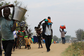 Congolese family who migrated from Democratic Republic of Congo by fleeing on a boat across Lake Albert, arrives in Ntoroko