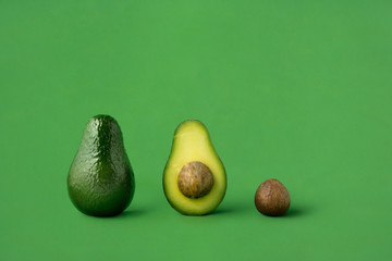Dinner is served / Creative concept photo of avocados on green background.