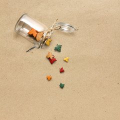 Happy Thanksgiving day / Creative thanksgiving day concept photo of leaves falling from the bottle on brown background.