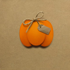 Happy Thanksgiving day / Creative thanksgiving day concept photo of pumpkin made of paper on brown background.