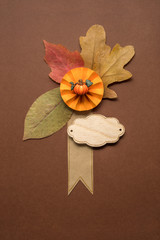 Happy Thanksgiving day / Creative thanksgiving day concept photo of leaves on brown background.