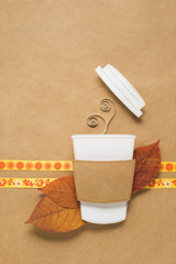 Hot drink / Creative concept photo of a cup of coffee made of paper on brown background.