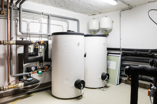 two big white boiler and heating net
