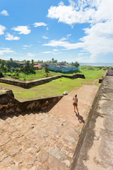 Sri Lanka, Galle - A woman visiting the medieval town wall of Galle