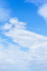Beautiful white cumulus clouds on blue sky