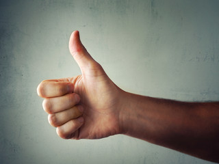 Thumbs Up Hand in Positive Approval Gesture