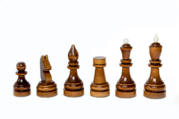 The shot of the black chess set of wood on the white background. The chess piece is isolated on white and a clipping path is provided for easy extraction.