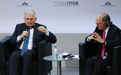 Turkish Prime Minister Yildirim and conference chairman Ischinger attend the Munich Security Conference in Munich