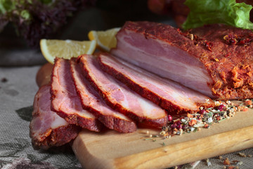 Smoked meat with spices and lemon .