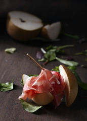 Wall Mural - Prosciutto with pear and spinach .