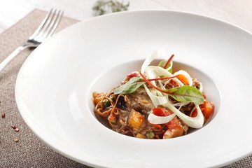 salad of stewed vegetables on a white wooden background