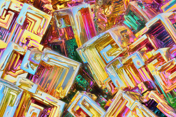 Amazing colorful rainbow Bismuth Gemstone Crystals macro closeup texture as background