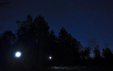 Flashlights on a starry night