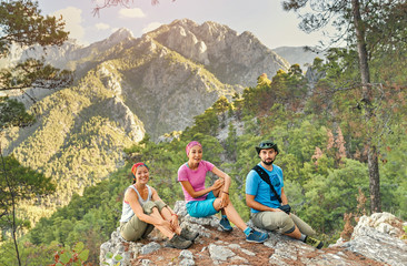 Young friends with backpacks enjoying view, traveling in canyon at Lycian Way