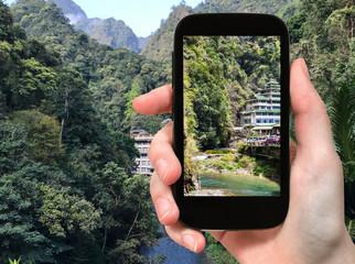 tourist photographs mountain brook in Longsheng
