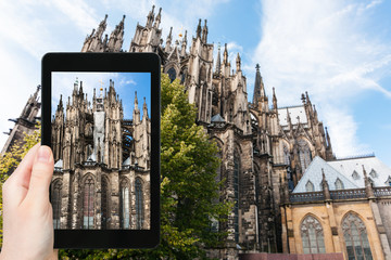 tourist photographs Cologne Cathedral in Germany
