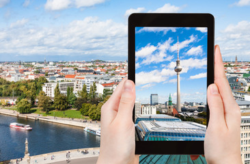 tourist photographs Berlin cityscape with TV Tower