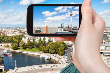 tourist photographs Berlin with TV Tower and Spree