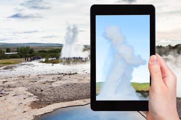 tourist photographs Strokkur geyser eruption