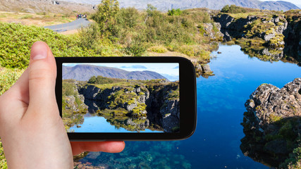tourist photographs Silfra fissure in rift valley