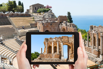 tourist photographs Greek Theater in Taormina