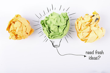 inspiration and get ideas concept, colorful crumple paper with bulb symbol over white background