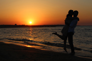 Lovers and beautiful sunset