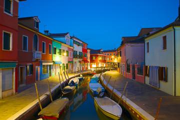 Night on the urban canal of the Burano island. Venice, Italy