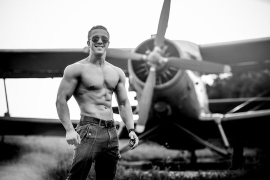 A man in front of a airplane.