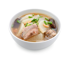 soup radish with pork serve on bowl, thai food isolated on white background
