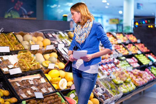 Young woman with shopping list