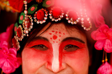 A performer wears a costume during Spring Festival celebrations marking Chinese New Year in Badachu park in Beijing