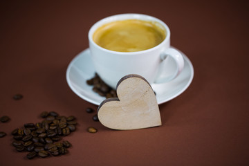 cup of coffee with heart, brown background, invitation, card