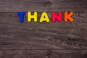 Word Thank from wooden letters