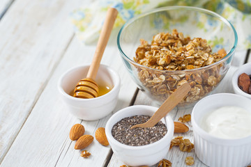 breakfast with granola on wooden surface