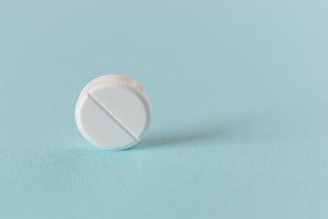 White pills on the bright blue background.