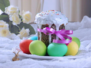 Easter cake -  traditional  Orthodox Christian Kulich, Paska Easter bread and easter colorful eggs.