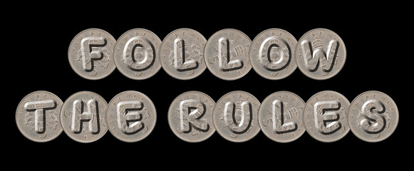 FOLLOW THE RULES – Coins on black background