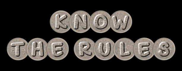 KNOW THE RULES – Coins on black background