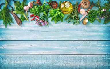 fresh herbs and spices on wooden table