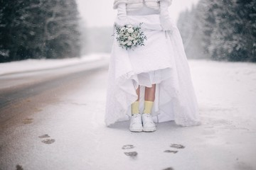 bride in sneakers in winter.