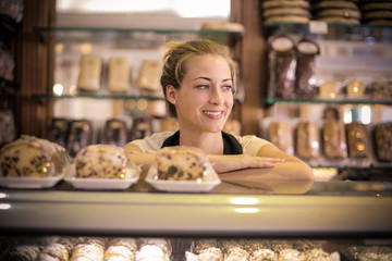 Happy pastry chef in her shop
