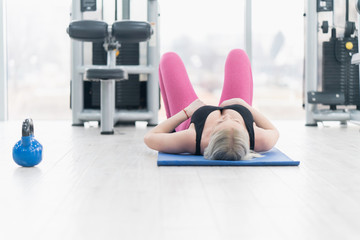 Woman Kettlebell training in gym
