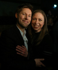 Burberry Chief Creative Officer Christopher Bailey poses for a photograph with Chelsea Clinton after the Burberry show at London Fashion Week