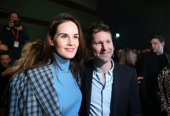 Burberry Chief Creative Officer Christopher Bailey poses for a photograph with actor Michelle Dockery after the Burberry show at London Fashion Week