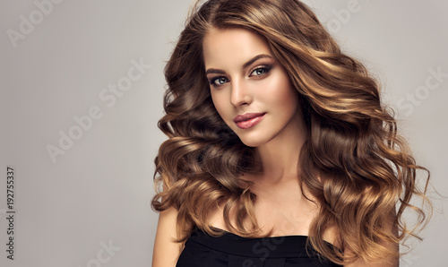 Brunette Girl With Long And Shiny Wavy Hair Beautiful Model With