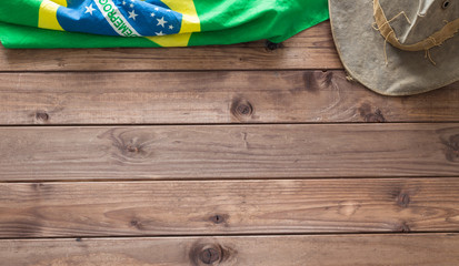 Brazilian symbols on a wooden background with space for inscription.