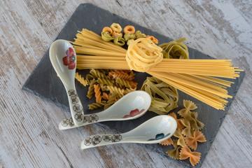 Raw pasta salad with porcelain spoon on slate dish II