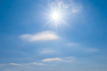 beautiful blue sky background with sparkle sun