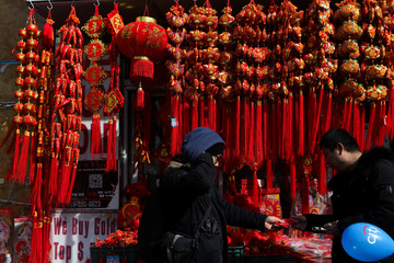 Man buys decorations at the Flushing Lunar New Year Parade in Queens, New York